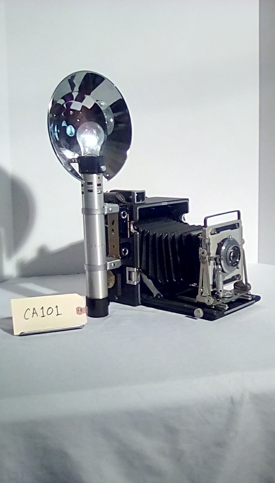 CA101 Reporter Camera, Speed Graphic, w/electronic flash, accordion fold lens