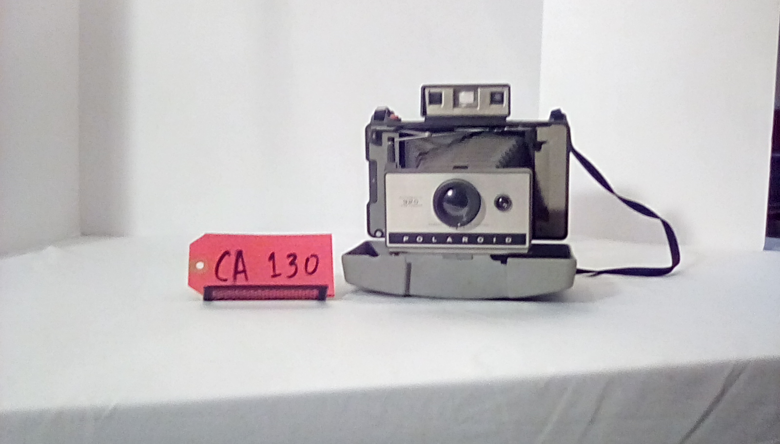 CA130 Polaroid Automatic 320 Land camera, accordion bellows, case and strap are attached to camera