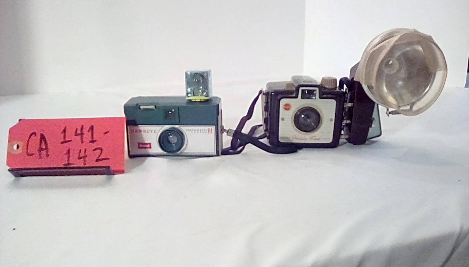 CA141 Kodak instamatic R4 w/flashcube & wrist strap, CA142 Brownie Holiday w/flash, neck strap, Bulb cover, & bulbs,