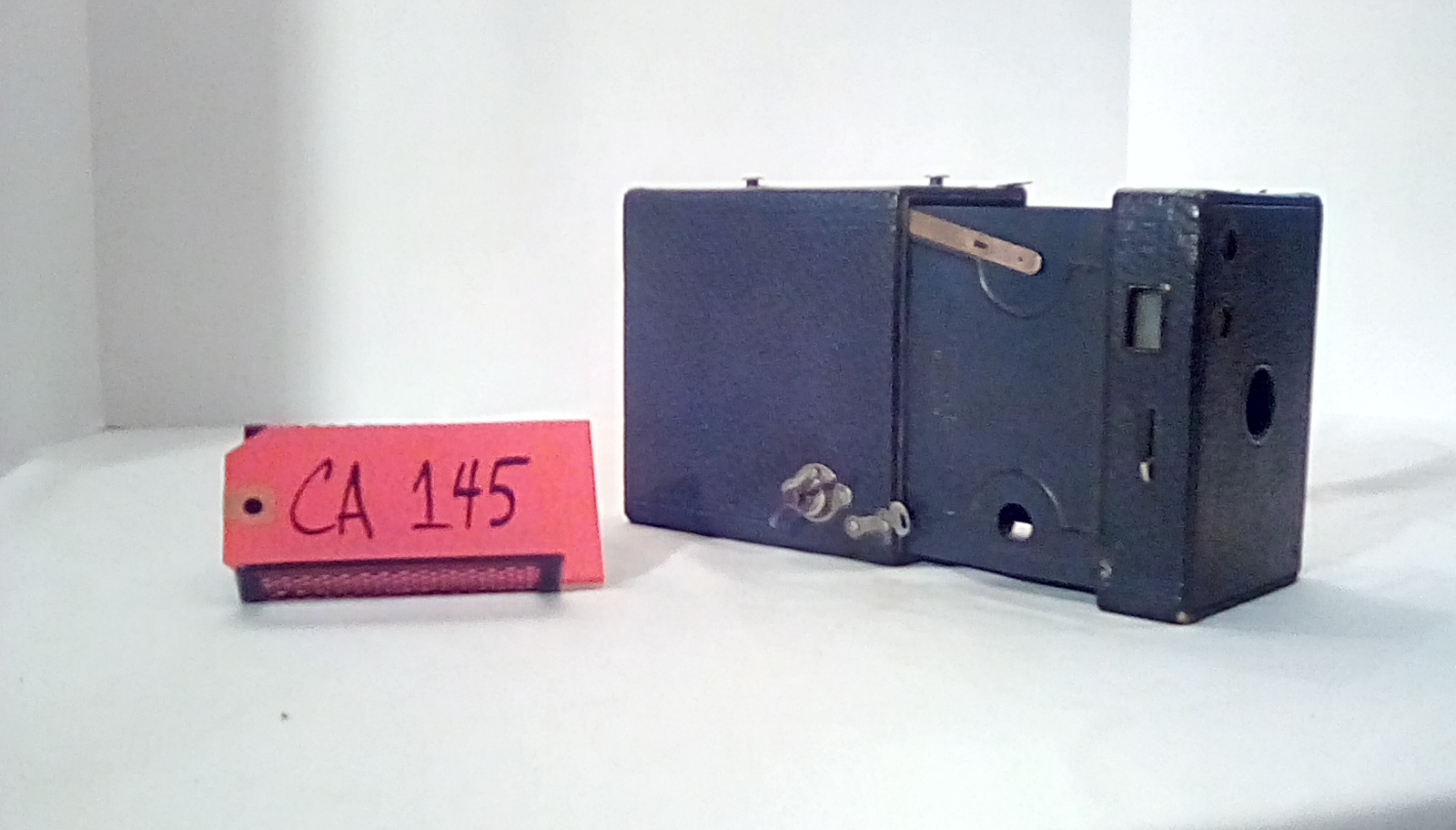 CA145 Brownie #2A, Model B, (3 pics of this camera), You need to wind  this camera  to open and close it. Tutorial available if needed.