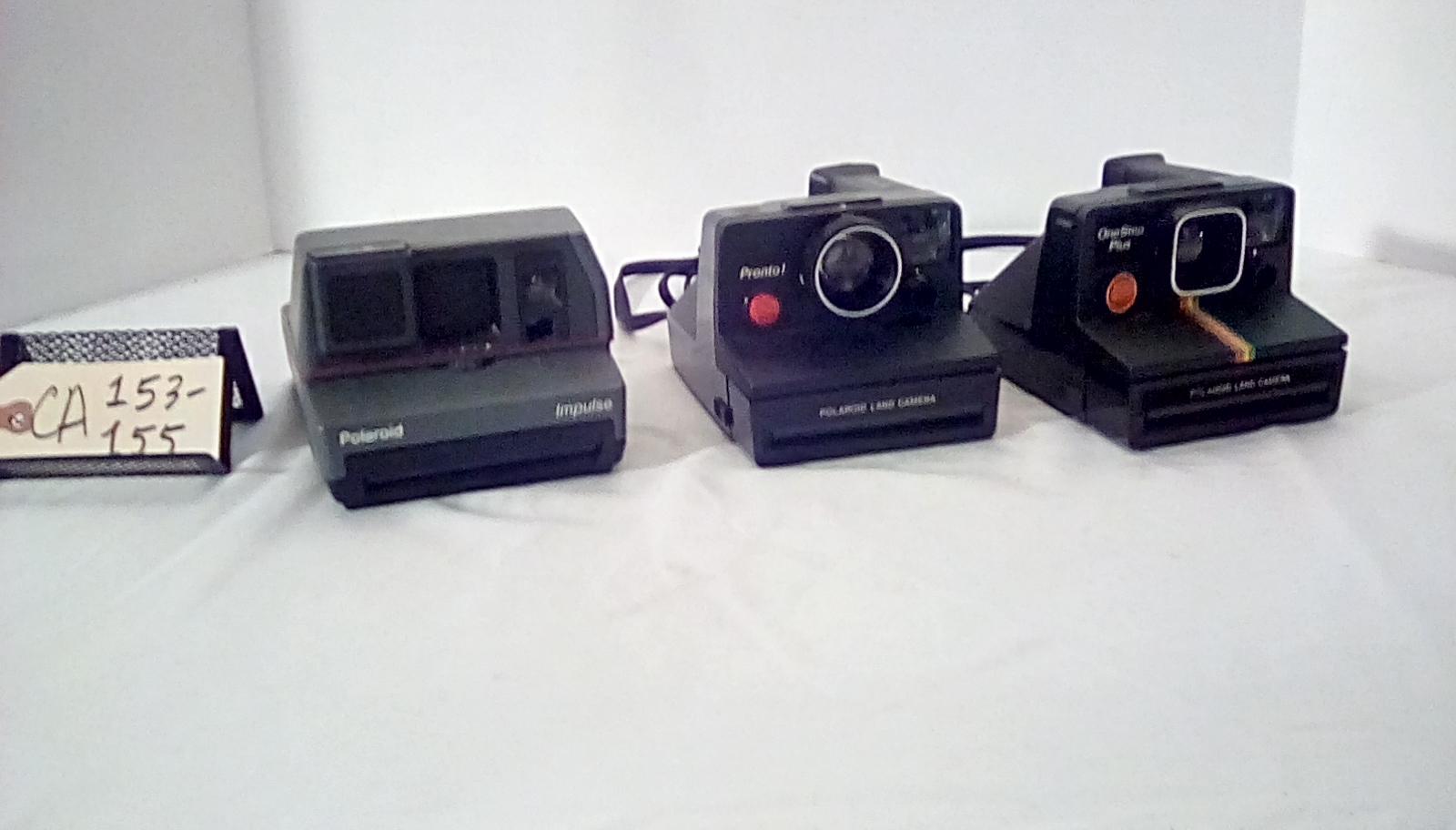 CA153 Polaroid impulse, grey w/red pinstripe, CA154 Polaroid Land camera PRONTO!, black red button to right of lens, CA155 Polaroid Land camera, 1 step plus, black, vertical rainbow stripe