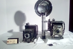 CA119-CA120, reporter camera, hawkeye, speed graphic  w/cap, w/electronic flash, accordion fold