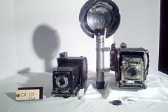 CA119-CA120, reporter camera, hawkeye, speed graphic  w/cap, w/electronic flash, accordion fold