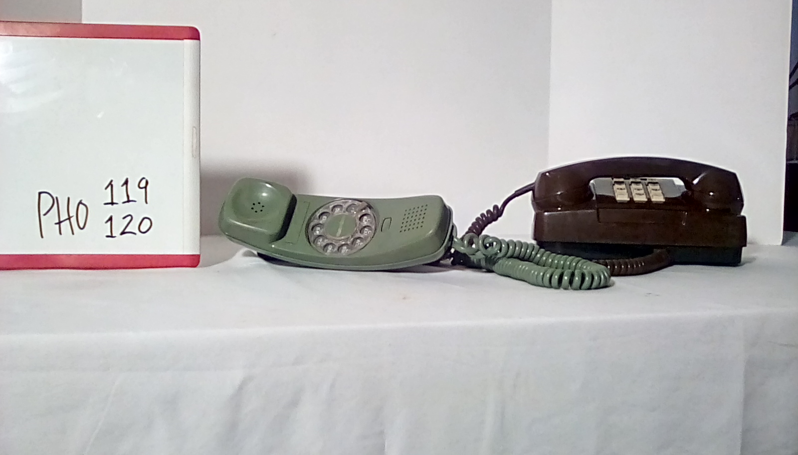 PHO119 Trimline green rotary desk phone, PHO120 brown 1970's princess push button desk phone