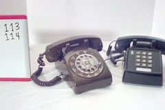 PHO113 Brown rotary desk phone, PHO114 Black push button desk phone